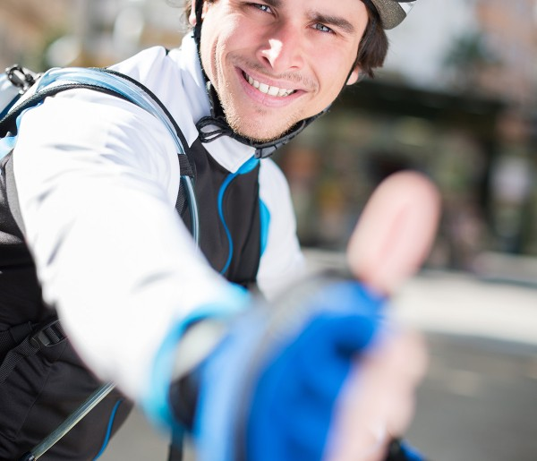 Male Cyclist Showing Thumb Up Sign